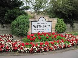 Photo of road side sign - Welcome to Wetherby twinned with Privas