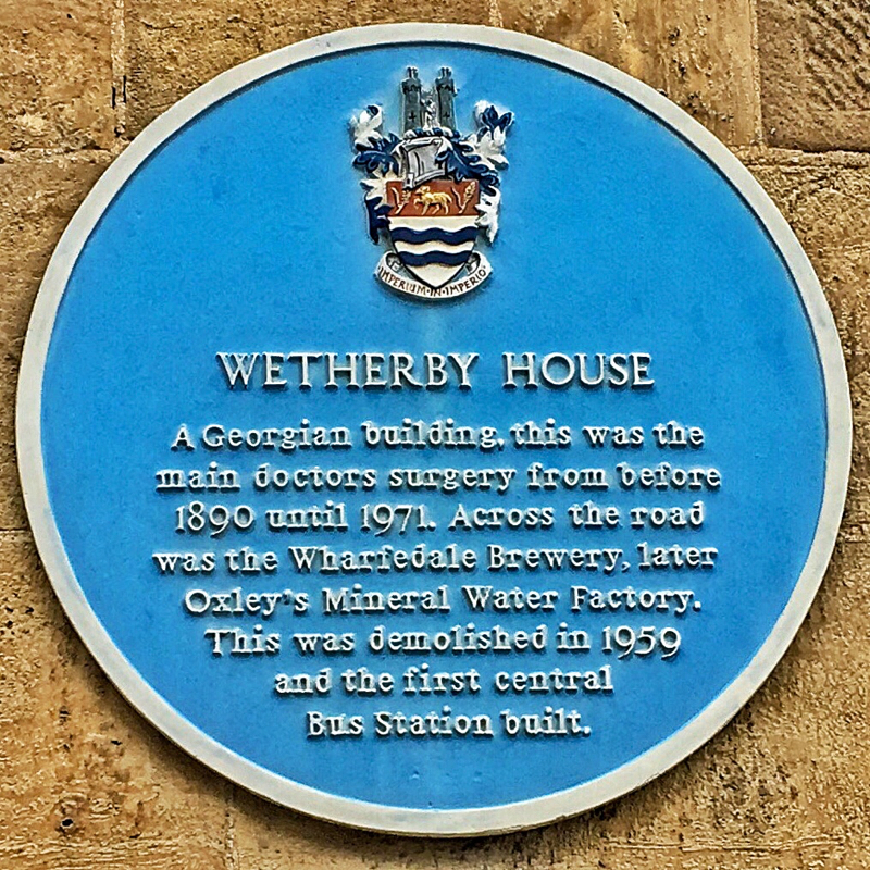 A photo of the Wetherby House Plaque - text below