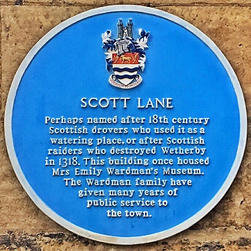 A photo of the Scott Lane plaque - text below