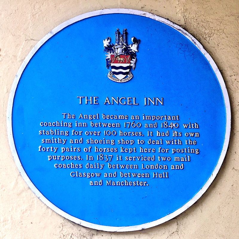 Photo of The Angel Inn blue plaque - text below