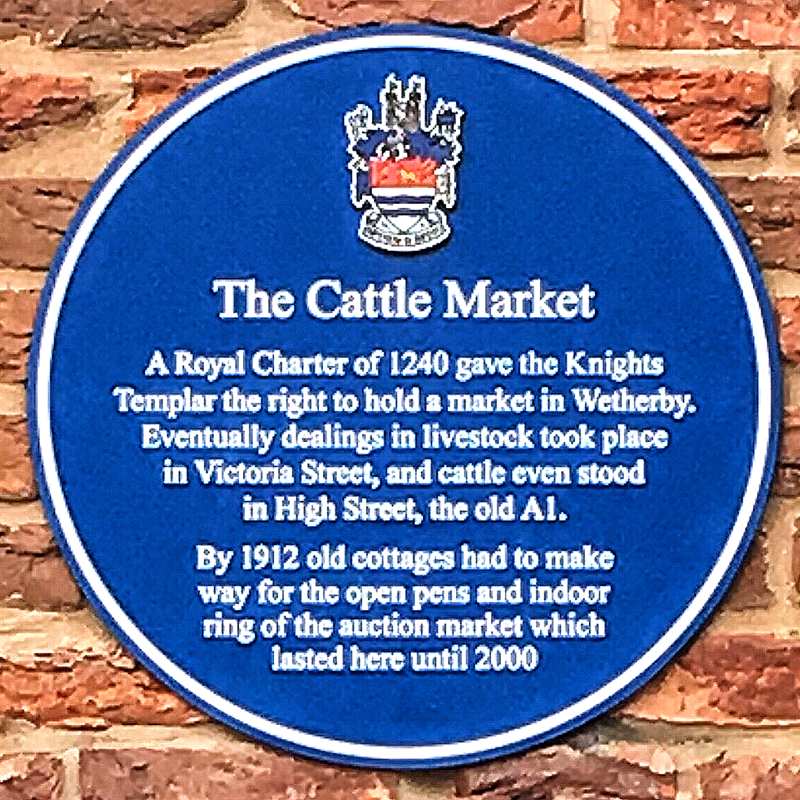 Photo of The Cattle Market blue plaque - text below