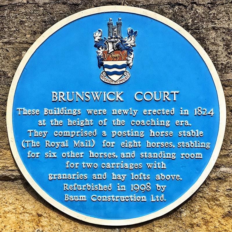 Photo of the Brunswick Court blue plaque - text below