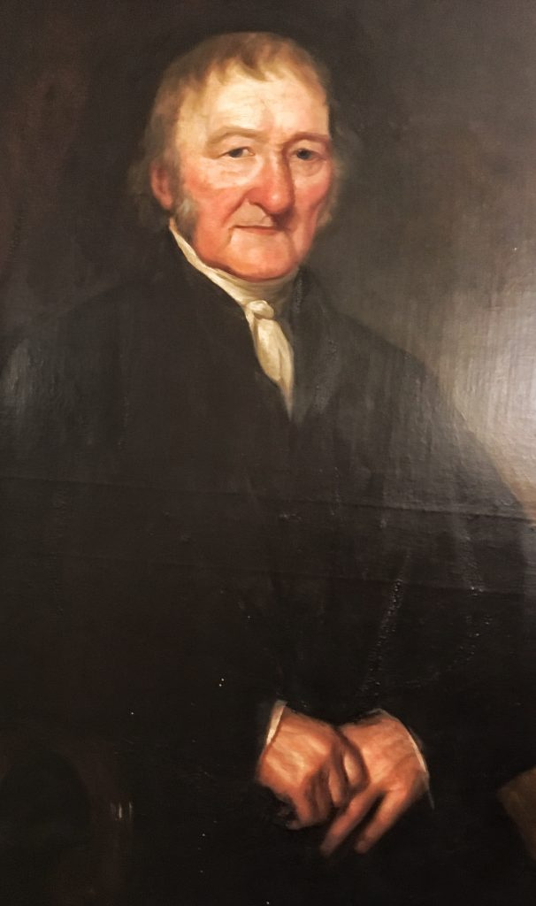 Photo of the portrait of Quentin Rhodes which hangs in Wetherby Town Hall.