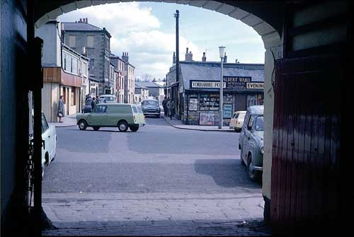 1965 View of the Market Place through the arched coach entrance of the Three Legs