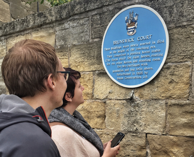 Picture of couple looking at Brunswick Court Blue Plaque