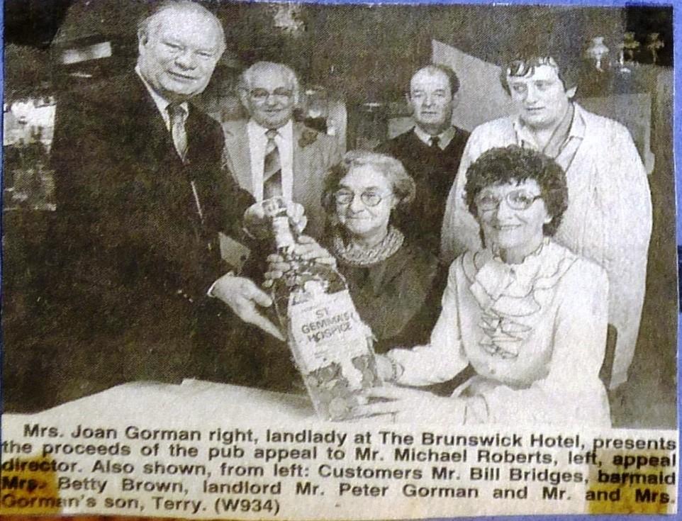 Landlady Joan Gorman presents pub appeal proceeds 1983