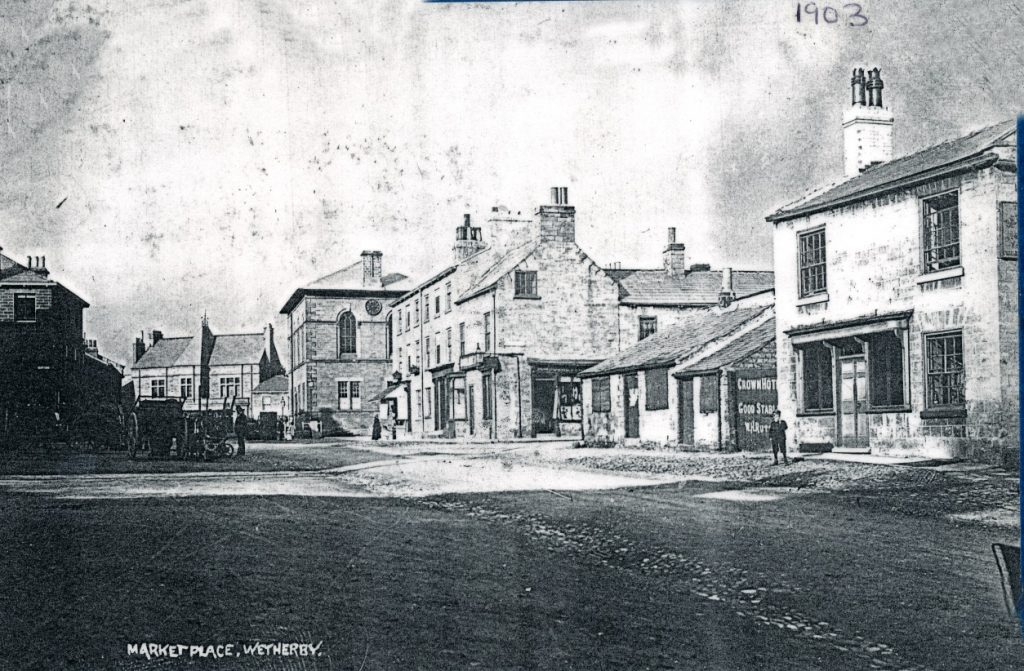 Market Place 1903 showing Crown Hotel gates & good stables.